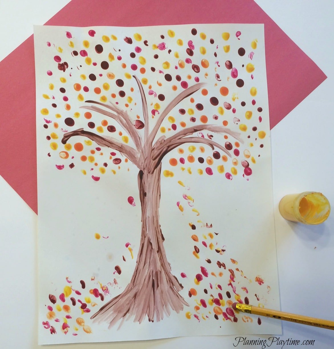 Fall Tree art project for kids using a pencil eraser to stamp the leaves.