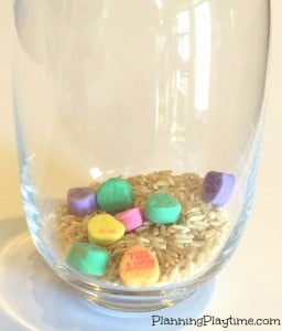 Planning Playtime Sensory Jar with rice and candy hearts.