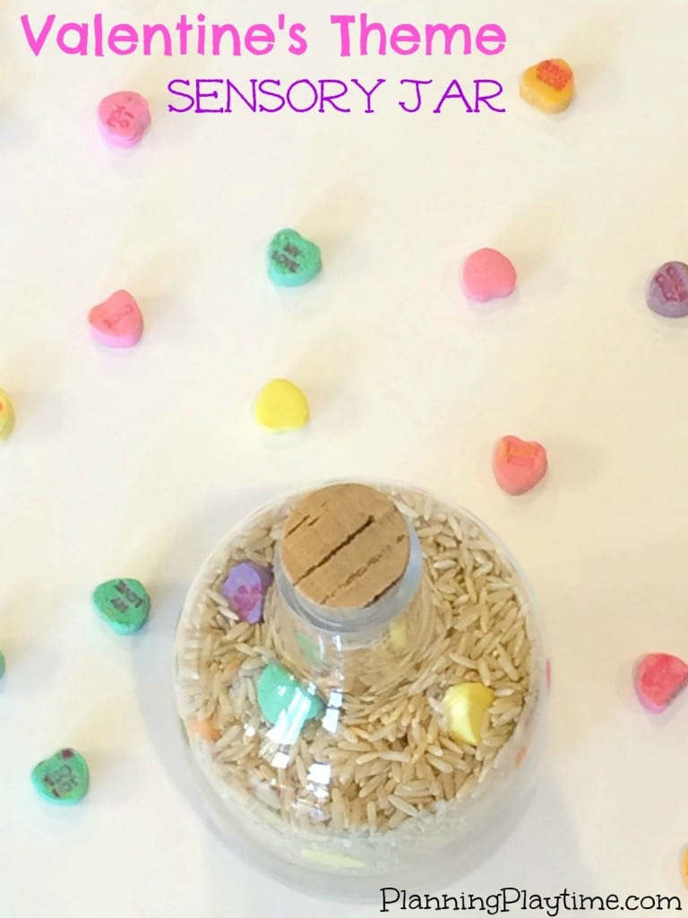 Sensory Jar with a Valentine's Theme. Just use rice and candy hearts. So fun!
