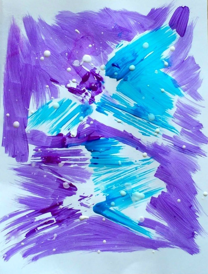 Winter Storm Art Project for kids created by paining over spaghetti noodles and then splattering white paint over the top. -PlanningPlaytime
