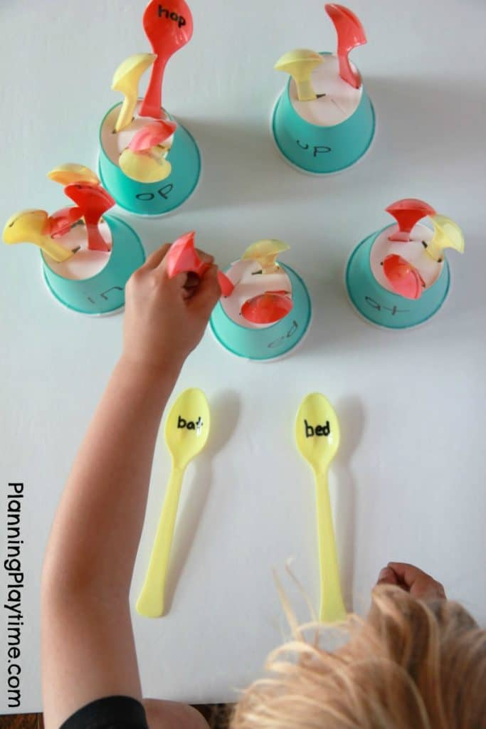 Word Families Reading Activity - Read the Spoons and place them into the holes on the right cups.