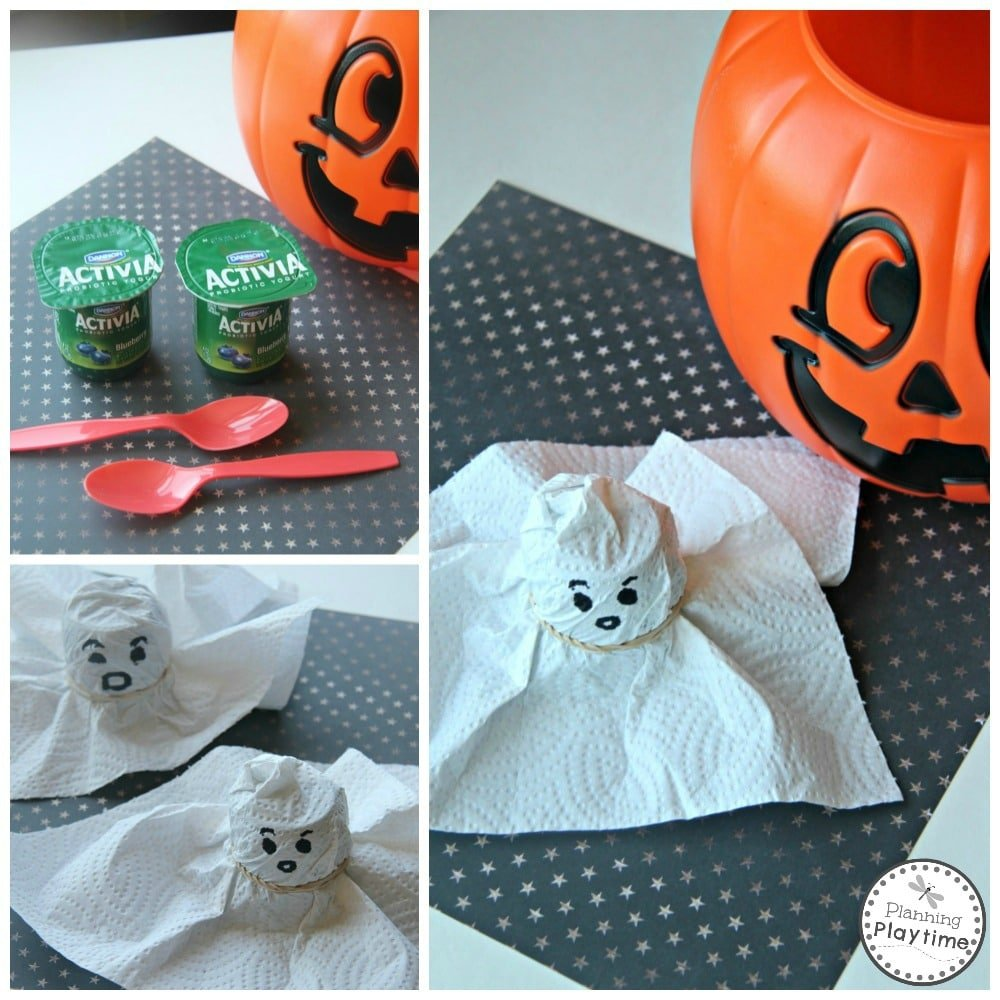 Healthy Halloween Ghost Snacks for School Parties - Made with yogurt or applesauce cups and a paper towel.
