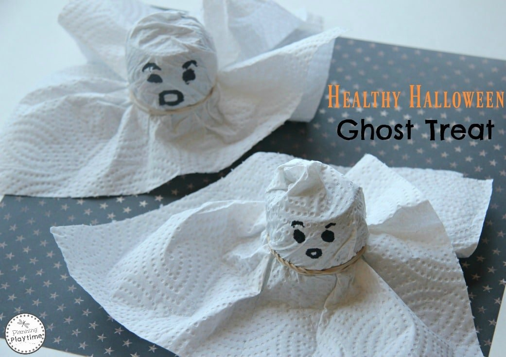 Healthy Halloween Ghosts Snacks made with yogurt or applesauce cups and a paper towel.