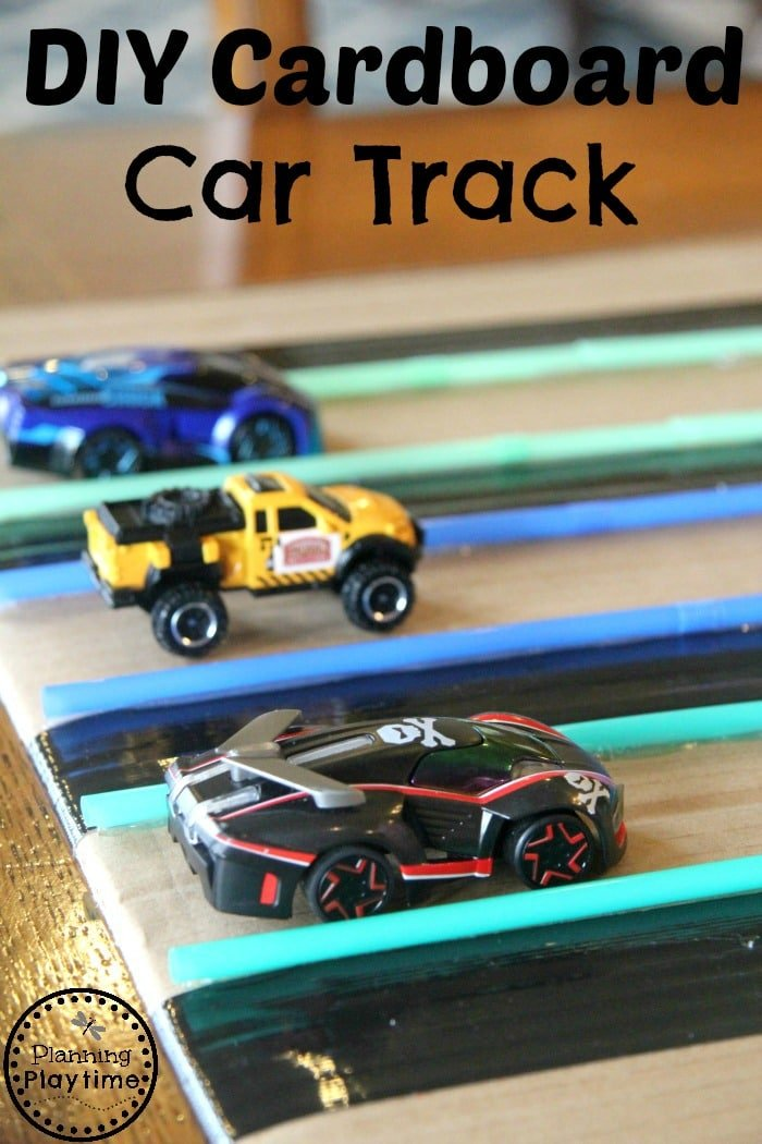 DIY Cardboard Car Track from an old box, drinking straws, and duct tape.