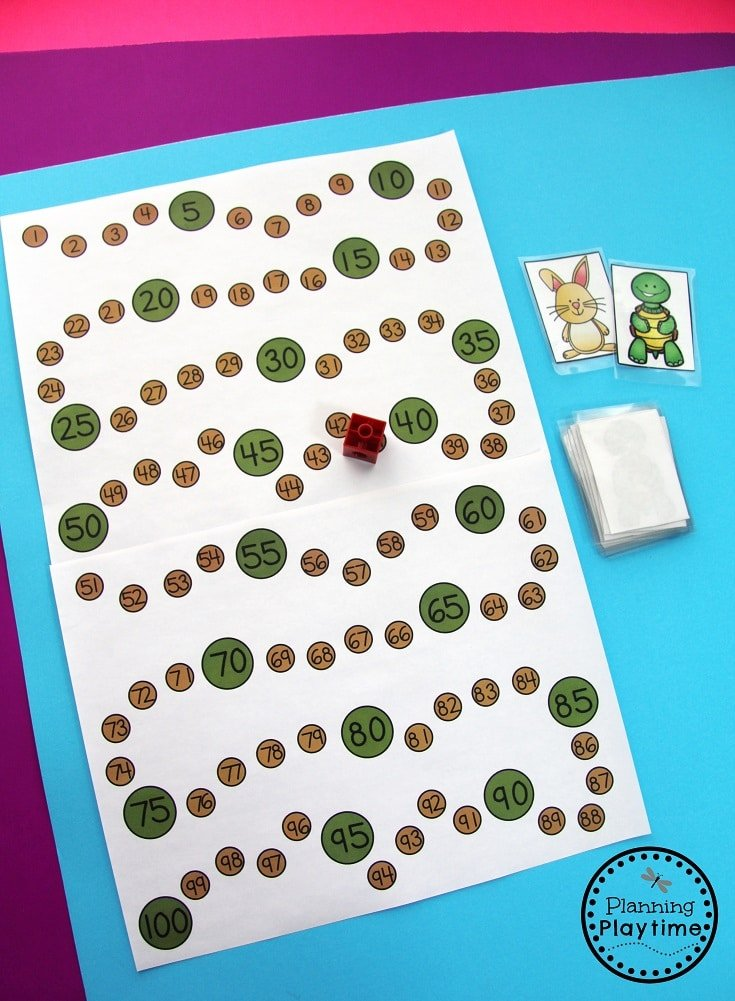 Counting by 10s and 1s. Move 10 spaces if you get a rabbit. Move 1 space if you get a turtle.