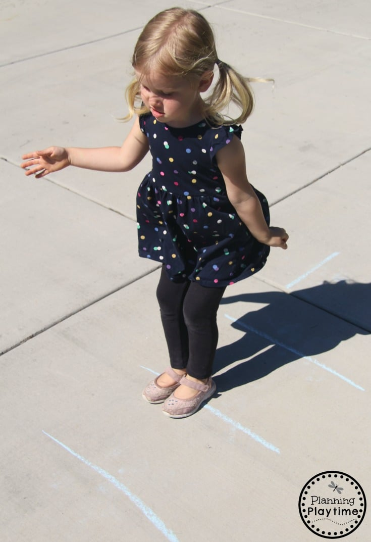 Chalk Obstacle Course - Gross Motor Toddler Activities for summer #toddler #toddleractivities #ideasfortoddlers #planningplaytime #ad #summerfun #outdoorplay