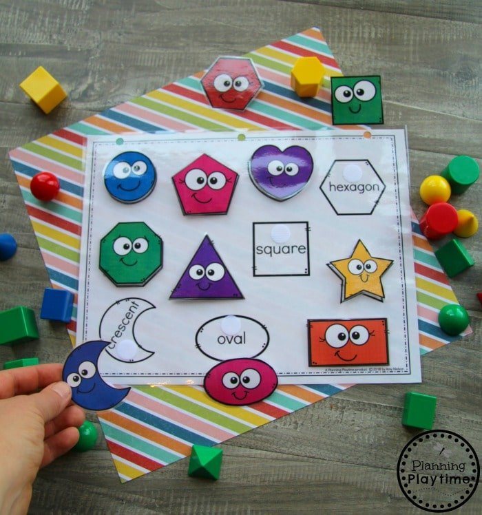 colored preschool shapes with velcro attached to black and white shape outlines with shape names