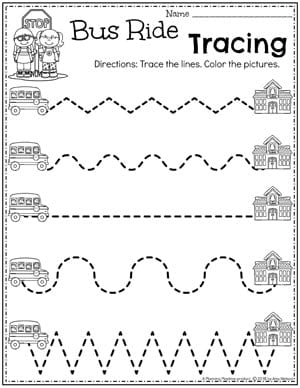 preschool worksheet with bus on tracing lines going towards schools