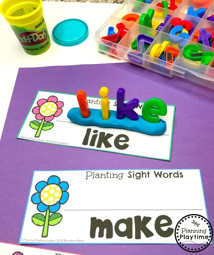 Sight words spelled with plastic letters pushed, standing upright, into playdough