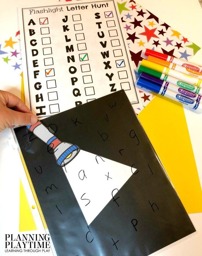 Alphabet Activities for Preschool Camping Theme - Flashlight Letter Hunt Bag #preschoolactivities #preschoolprintables #campingtheme #planningplaytime