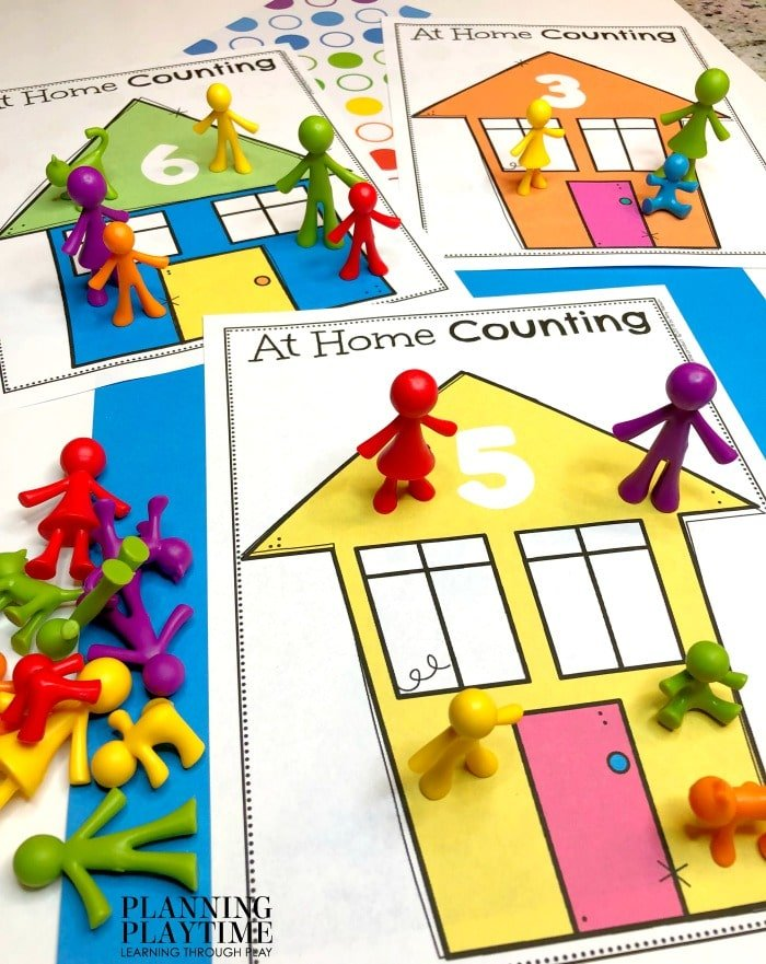 All About me printables - Colorful houses with a number and counted little people on it.