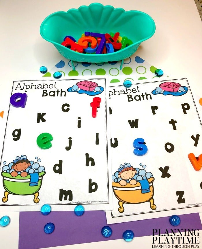 Preschool Activities - Letter Recognition Bath. Sensory bin with bubbles and a brush. So fun! #lettertracing #letterworksheets #alphabetworksheets #preschoolworksheets #preschoolactivities #alphabetactivities #planningplaytime